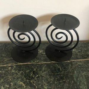 Two black metal candle stands